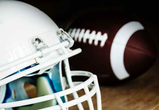 white american football helmet and pigskin ball
